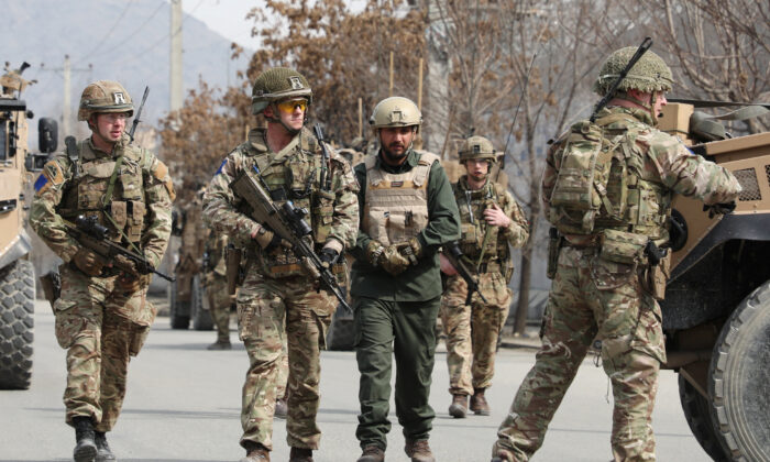 British soldiers with NATO-led Resolute Support Mission arrive at the site of an attack in Kabul, Afghanistan, on March 6, 2020. (Omar Sobhani/Reuters)