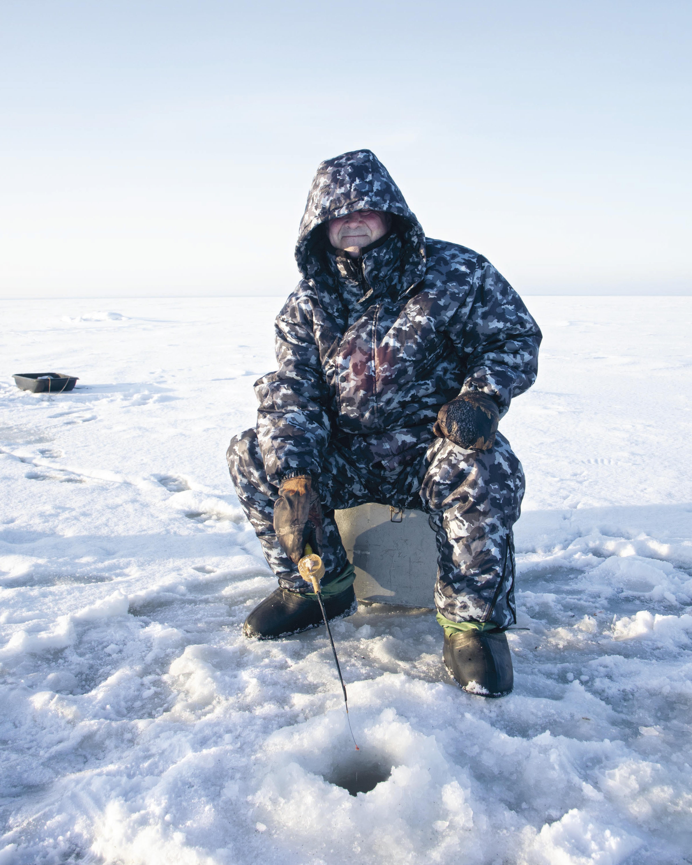 russian man ice fishing