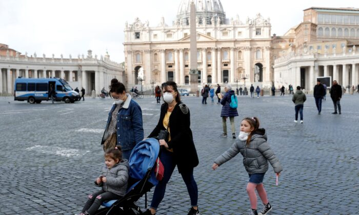 People wear protective face masks on St. Peter's Square after the Vatican reports its first case of coronavirus, at the Vatican, on March 6, 2020. (Remo Casilli/Reuters)