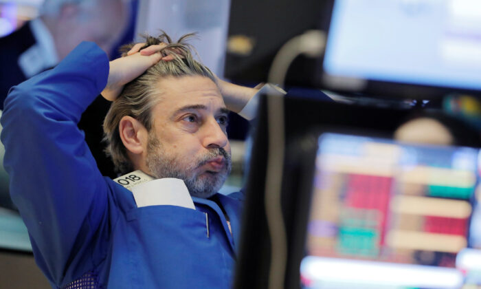 A trader works on the floor at the New York Stock Exchange in New York City on March 5, 2020. (Reuters/Andrew Kelly)