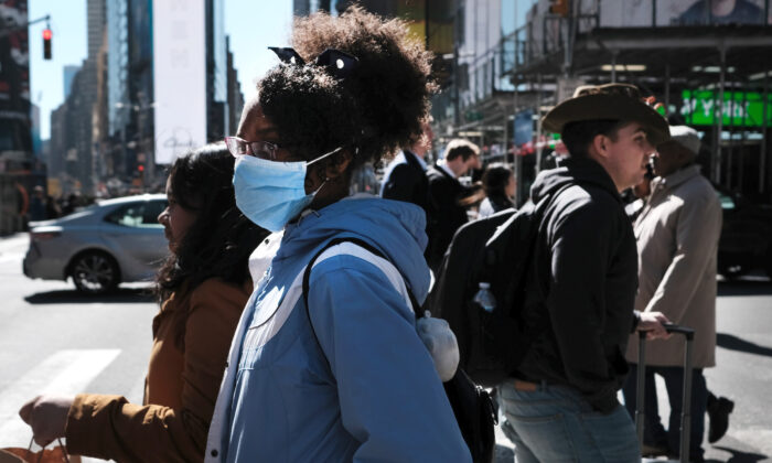 People walk through Manhattan with surgical masks in New York City on March 4, 2020. (Spencer Platt/Getty Images)