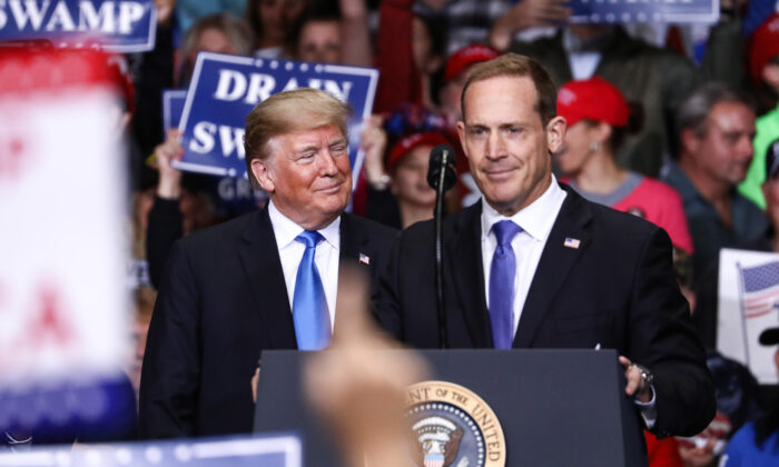 President Donald Trump (L) and GOP congressional candidate Ted Budd at a Make America Great Again rally in Charlotte, N.C., on Oct. 26, 2018. (Charlotte Cuthbertson/The Epoch Times)