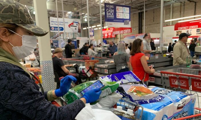Customers wait in line to buy water and other supplies, on fears that the coronavirus, COVID-19, will spread and force people to stay indoors, at a Costco in Burbank, California on March 6, 2020. (Robyn Beck/AFP via Getty Images)