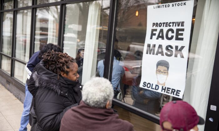 Customers line up outside of a coronavirus pop-up store in Washington on March 6, 2020. (Samuel Corum/Getty Images)