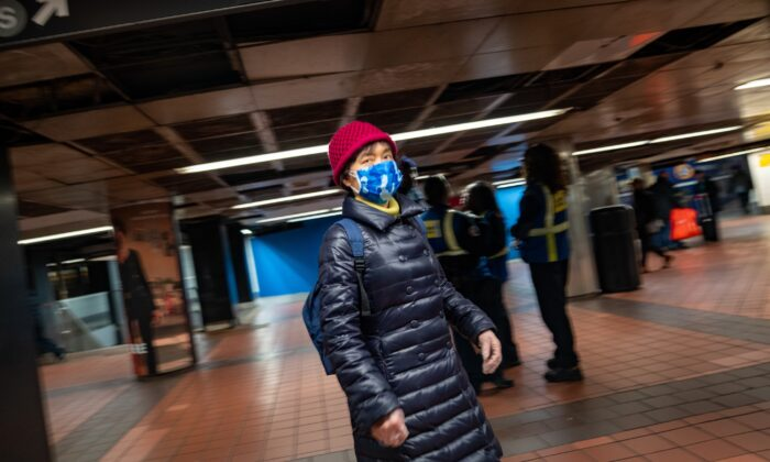 A woman wears a medical mask at Grand Central station in New York City on March 5, 2020. (David Dee Delgado/Getty Images)