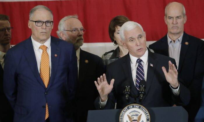 Vice President Mike Pence, at podium, speaks as Gov. Jay Inslee, left, and other officials look on during a news conference at Camp Murray in Washington state on March 5, 2020. Pence was in Washington to discuss the state's efforts to fight the spread of the COVID-19 coronavirus. (Ted S. Warren/AP Photo)