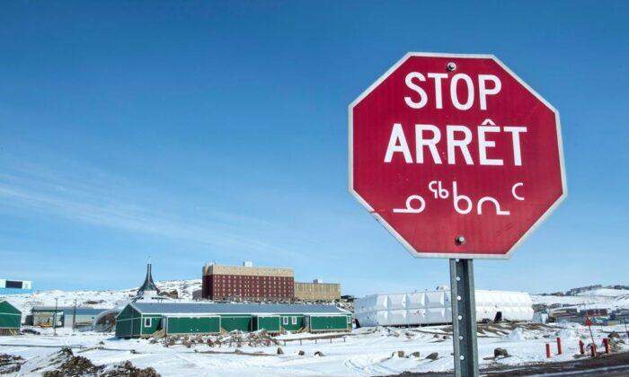 A stop sign in English, French and Inuit is seen in Iqaluit, Nunavut on April 25, 2015. (Paul Chiasson/The Canadian Press)