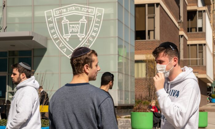 A Yeshiva University student wears a face mask on the grounds of the university in New York City on March 4, 2020. (David Dee Delgado/Getty Images)