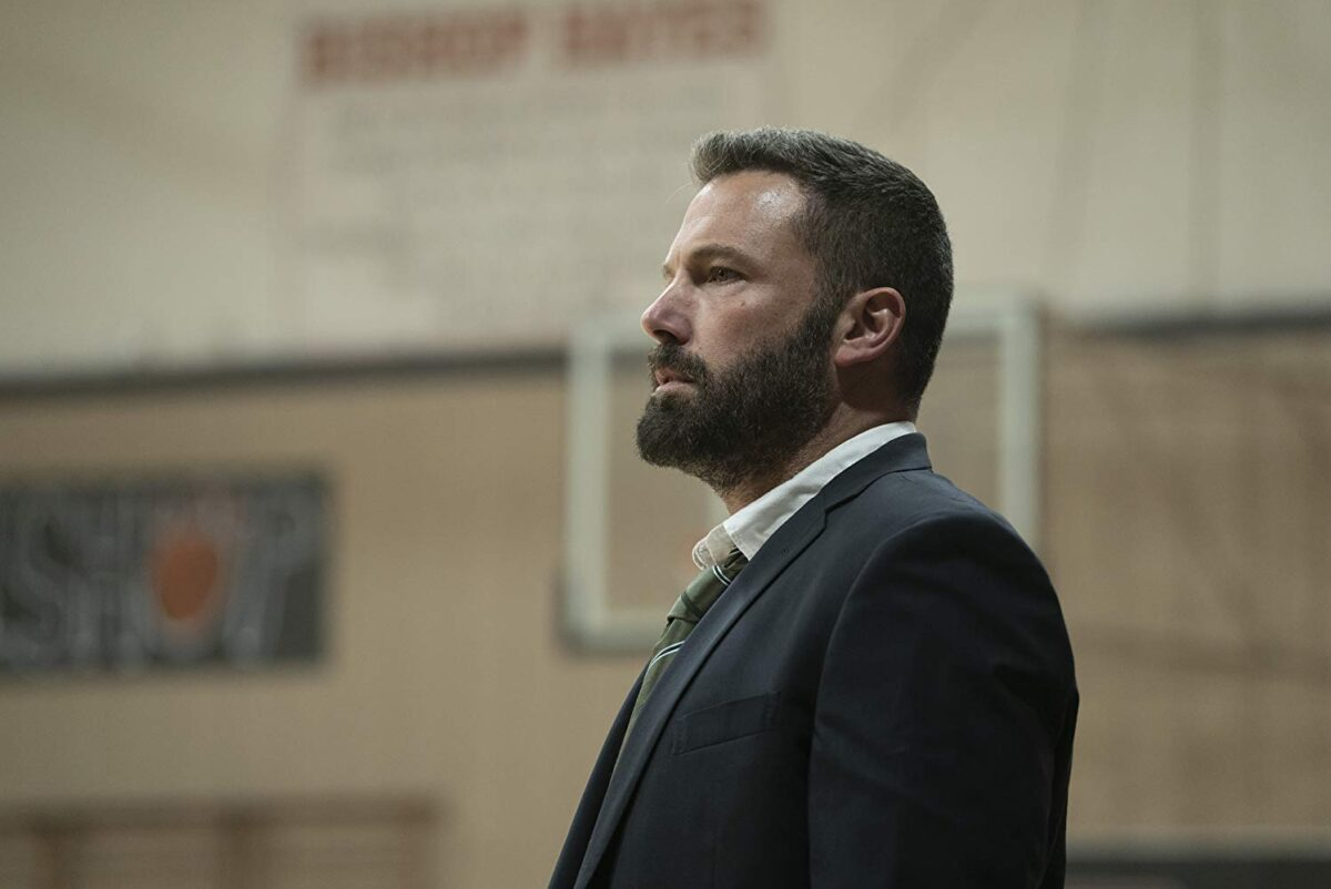 man with beard in dark suit