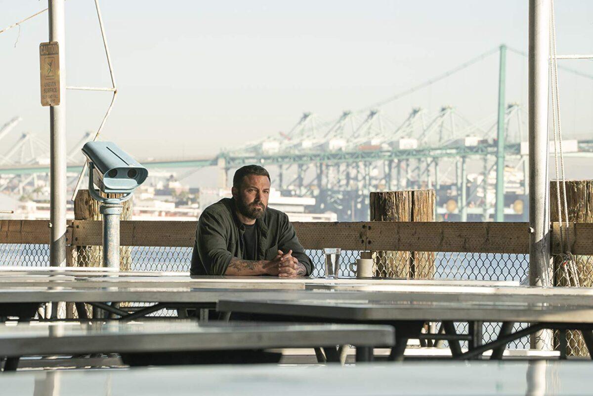 man sitting at table