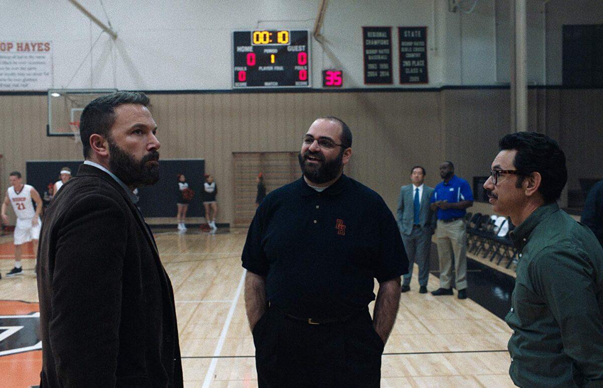 three men on basketball court