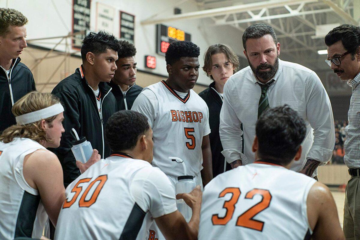 coach and basketball team