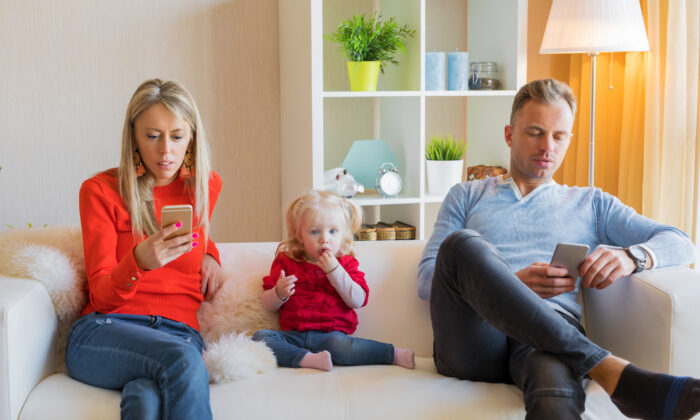 Children learn and develop their behavior by watching others, especially their parents, and this includes screen use. (Kaspars Grinvalds/Shutterstock)