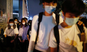 Hong Kong Pro-Democracy Protesters Hold Vigil to Mourn Student's Death