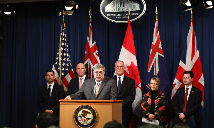 Attorney General William Barr speaks about an initiative to prevent online child sexual exploitation as international politicians look on, at the Justice Department in Washington on March 5, 2020. (Samira Bouaou/The Epoch Times)