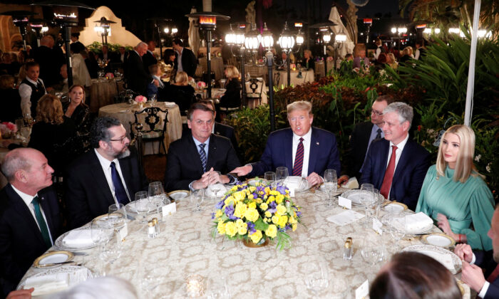 President Donald Trump hosts a working dinner with Brazilian President Jair Bolsonaro at the Mar-a-Lago resort in Palm Beach, Fla., on March 7, 2020. (Tom Brenner/Reuters)
