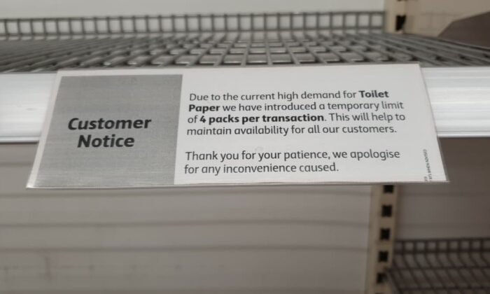 A notice limiting the volume of toilet paper customers can purchase is seen at a Coles supermarket in Melbourne, Australia, on March 7, 2020. (Alan Cheung/The Epoch Times)