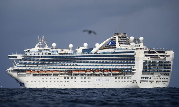 Carrying multiple people who have tested positive for COVID-19, the Grand Princess maintains a holding pattern about 30 miles off the coast of San Francisco on March 8, 2020. The cruise ship is scheduled to dock at the Port of Oakland on today, setting the stage for Ottawa to bring the 237 Canadians aboard the back home. (AP Photo/Noah Berger)