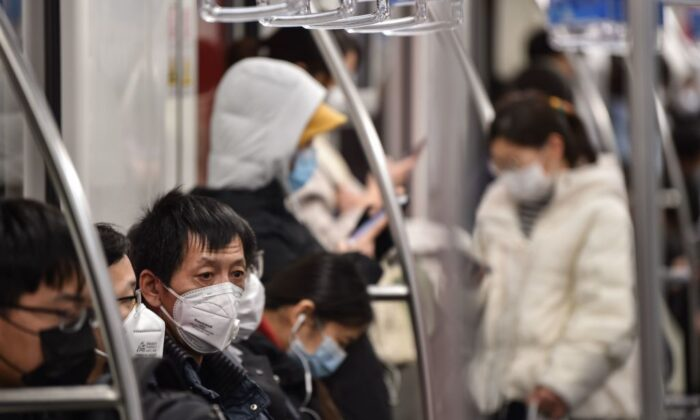 Passengers wearing face masks travel on a subway train in Shanghai on March 5, 2020. (Hector Retamal/AFP via Getty Images)