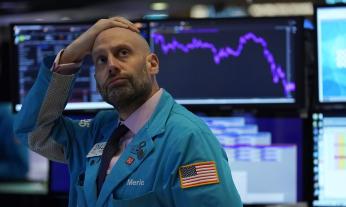 Meric Greenbaum looks up at the board before the opening bell right before trading halted on the New York Stock Exchange in New York on March 9, 2020. (Timothy Clary/AFP via Getty Images)