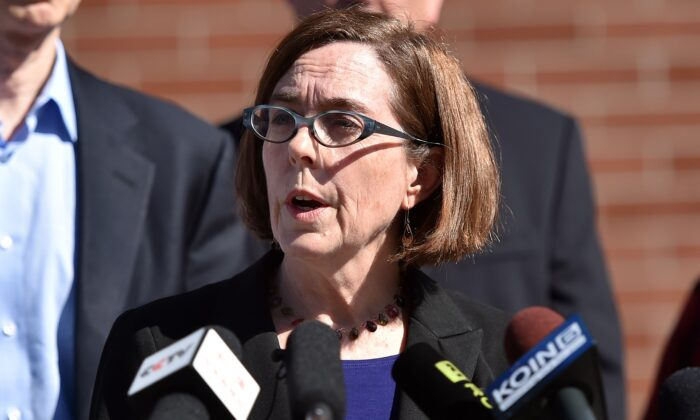 Oregon Governor Kate Brown reacts during a press conference in Roseburg, Oreg. on Oct. 2, 2015. (Josh Edelson/AFP via Getty Images)