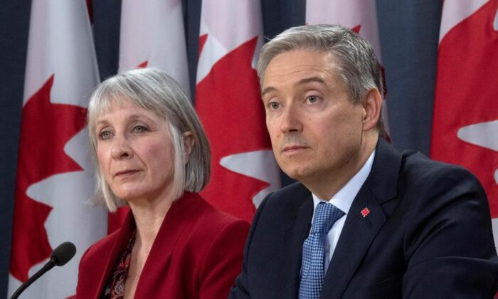 Minister of Foreign Affairs Francois-Philippe Champagne and Minister of Health Patty Hajdu listen to a question from the media during a news conference in Ottawa on March 9, 2020. (The Canadian Press/Adrian Wyld)