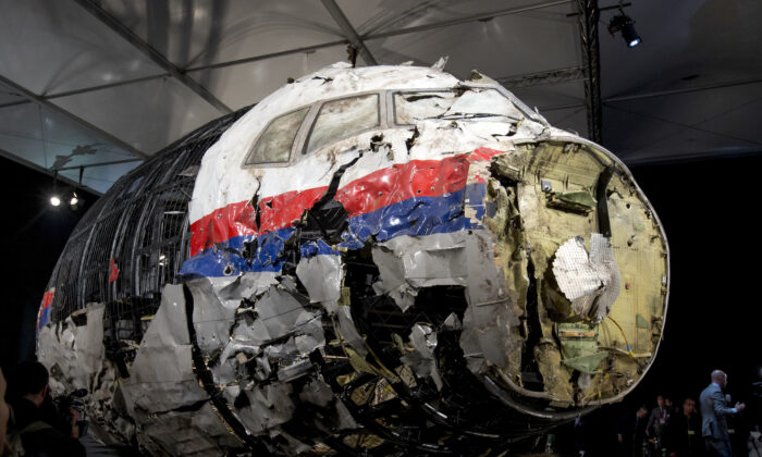 The reconstructed wreckage of Malaysia Airlines Flight MH17, put on display during a press conference in Gilze-Rijen, central Netherlands, on Oct. 13, 2015. (Peter Dejong/AP Photo)