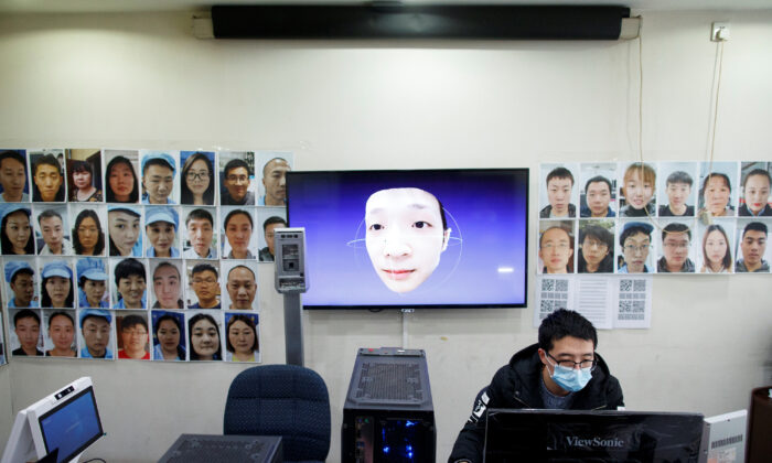 A software engineer works on a facial recognition program that identifies people when they wear a face mask at the development lab of the Chinese electronics manufacturer Hanwang (Hanvon) Technology in Beijing, China as the country is hit by an outbreak of the novel coronavirus (COVID-19), on March 6, 2020. (Thomas Peter/Reuters)