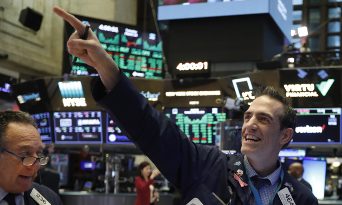 Traders Steven Kaplan, left, and Gregory Rowe react at the closing on the floor of the New York Stock Exchange, Tuesday, March 10, 2020. (Richard Drew/AP)