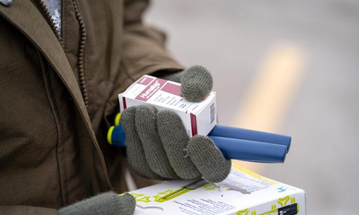 An individual holds insulin medicine in Minnetonka, Minn., on Jan. 17, 2020. (Kerem Yucel/AFP via Getty Images)