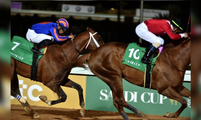 Jockey Luis Saez (L) rides his horse Maximum Security as he competes in the 20 million US dollar race, the final race of the Saudi Cup -- the world's richest horserace -- at the King Abdulaziz Racetrack in Jenadriyah near the capital Riyadh, Saudi Arabia, on Feb. 29, 2020. (Fayez Nureldine/AFP via Getty Images)