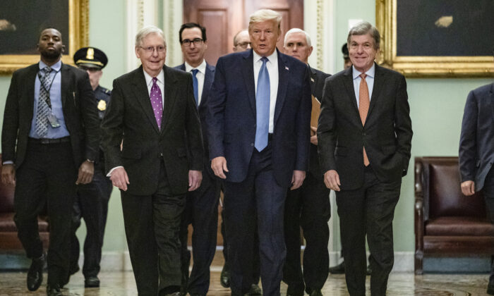 President Donald Trump  arrives at the US Capitol to attend the Republicans weekly policy luncheon in Washington on March 10, 2020. He is flanked by (from left to right) Senate Majority Leader Mitch McConnell (R-KY), Treasury Secretary Steve Mnuchin, Vice President Mike Pence, and Republican Policy Committee Chairman Senator Roy Blunt (R-MO). (Samuel Corum/Getty Images)