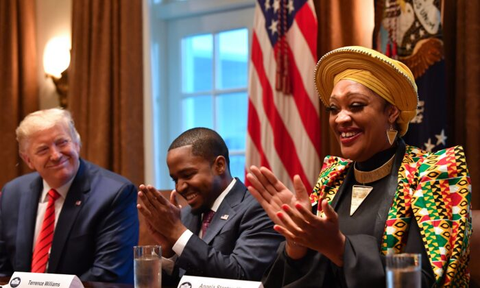 President Donald Trump next to Terrence Williams (C) and Angela Stanton-King during a meeting with African American leaders in the Cabinet Room of the White House in Washington on Feb. 27, 2020. (Nicholas Kamm/AFP via Getty Images)