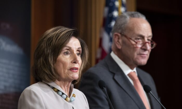 House Speaker Nancy Pelosi (D-Calif.) joined by Senate Minority Leader Chuck Schumer (D-N.Y.) speaks during a news conference on Capitol Hill in Washington on Feb. 11, 2020. (Alex Brandon/AP Photo)