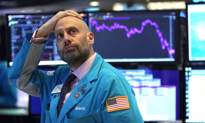 An employee reacts to market data on display at the New York Stock Exchange on March 9, 2020 in New York. (Timothy Clary/AFP via Getty Images)