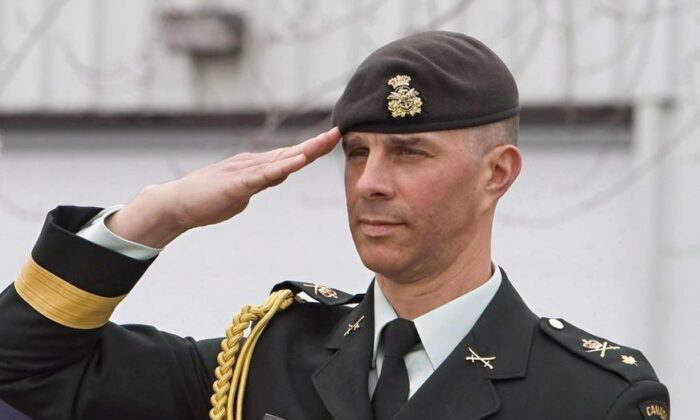 Brigadier General Jean-Marc Lanthier attends a ceremony honouring soldiers who participated in the war in Afghanistan, on May 9, 2014 at CFB Valcartier. (Clement Allard/The Canadian Press)