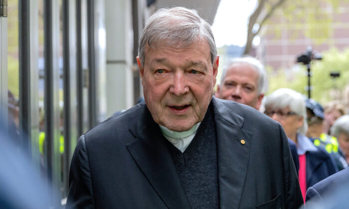 Vatican Treasurer Cardinal George Pell is surrounded by Australian police as he leaves the Melbourne Magistrates Court in Australia on Oct. 6, 2017. (Mark Dadswell/Reuters File)