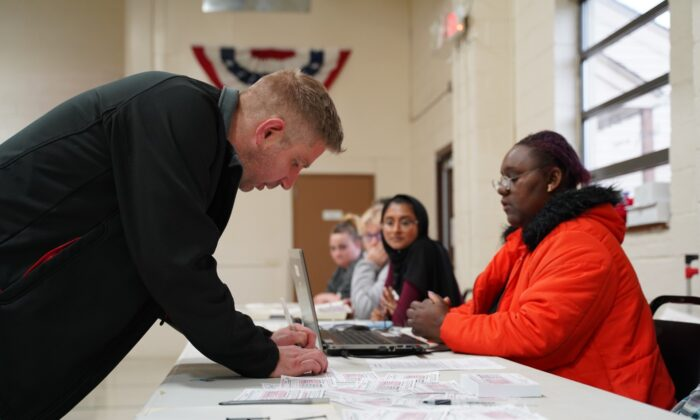 A voter fills out a ballot selection form at the voting center in Fitzgerald Recreation Center in Warren, Mich., on March 10, 2020. (Cara Ding/The Epoch Times)