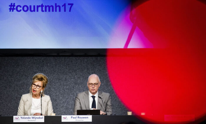 District Court of The Hague Dutch press judge Yolande Wijnnobel (L) speaks past Dutch press judge Paul Rouwen about the first session of the international MH17 trial in Badhoevedorp, The Netherlands, on March 9, 2020. (Remko De Waal/ANP/AFP via Getty Images)