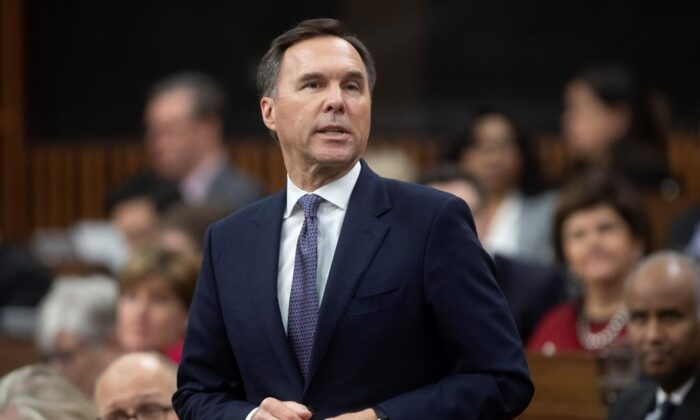 Finance Minister Bill Morneau rises during Question Period in the House of Commons in Ottawa,on March 11, 2020 .(Adrian Wyld/The Canadian Press)