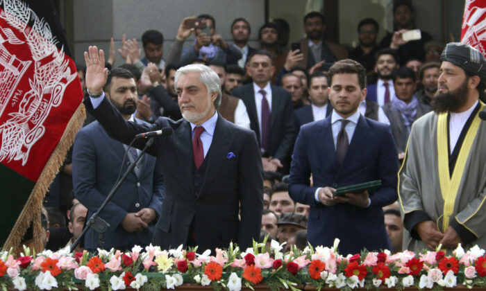 Afghanistan's Abdullah Abdullah, front left, greets his supporters after being sworn in as president in Kabul, Afghanistan on March 9, 2020. (AP Photo)