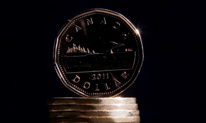 Canadian dollars are pictured in Vancouver on Sept. 22, 2011. (Jonathan Hayward/The Canadian Press)