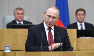 Putin Backs Term-Limit Freeze Allowing Him to Stay in Office