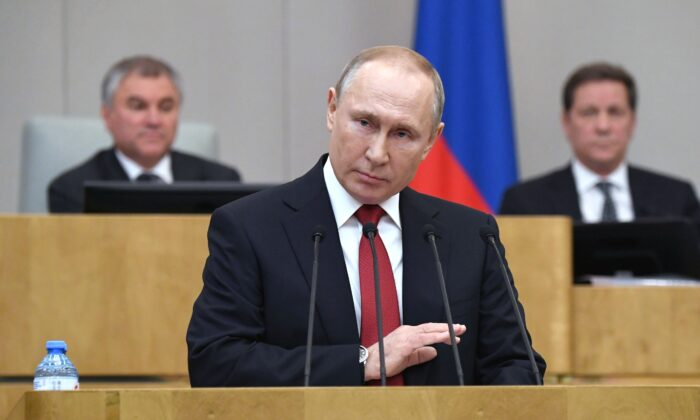 Russian President Vladimir Putin addresses lawmakers debating on the second reading of the constitutional reform bill during a session of the State Duma, Russia's lower house of parliament, in Moscow on March 10, 2020. (Alexey Nikolsky/Sputnik/AFP via Getty Images)