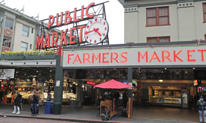 Pike Place Fish Market at the Pike Place Market in Seattle is nearly devoid of root traffic and crowds at the close of the day on March 6, 2020. (Ted S. Warren/AP)