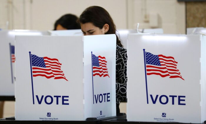 People vote in the Michigan primary election at Chrysler Elementary School in Detroit, Michigan, on March 10, 2020. (Jeff Kowalsky/AFP via Getty Images)