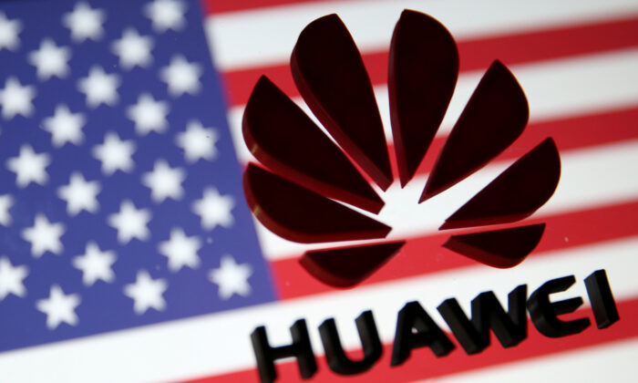 A 3D-printed Huawei logo is placed on glass above a displayed U.S. flag in this illustration taken on Jan. 29, 2019. (Dado Ruvic/Illustration/Reuters)