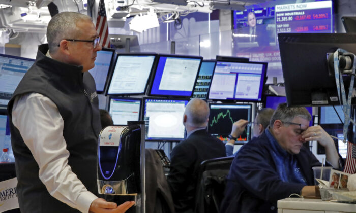 A trader on the floor of the New York Stock Exchange, Thursday, March 12, 2020.  on Wall Street. (AP Photo/Richard Drew)