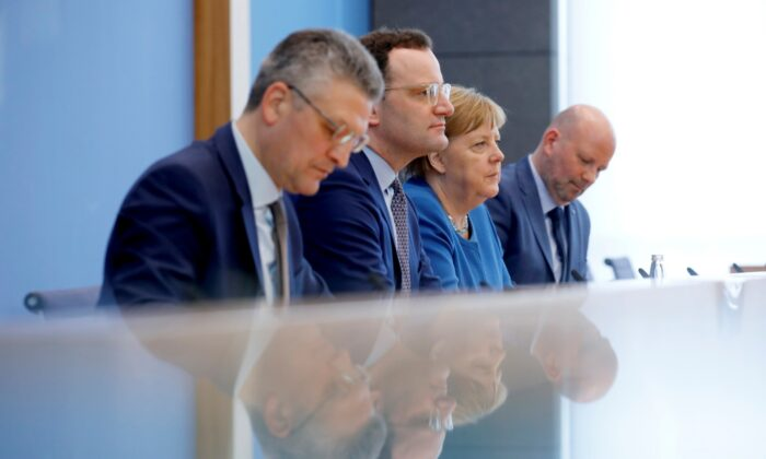 German Chancellor Angela Merkel, Health Minister Jens Spahn, and a head of the Robert Koch Institute Lothar Wieler address a news conference on coronavirus in Berlin on March 11, 2020. (Axel Schmidt/Reuters)