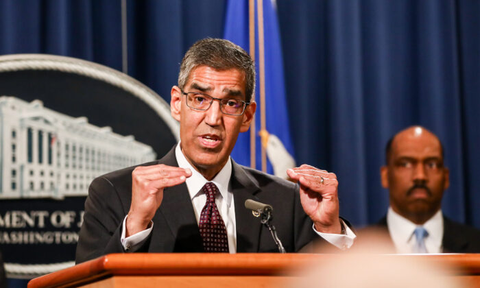 Acting DEA Administrator Uttam Dhillon, flanked by DEA and DOJ officials, speaks to media about an operation against a Mexican cartel at the Justice Department in Washington on March 11, 2020. (Charlotte Cuthbertson/The Epoch Times)